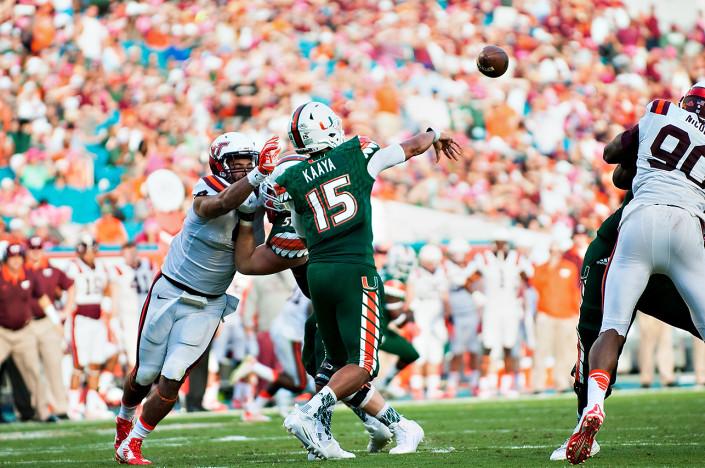 Miami Hurricanes QB #15, Brad Kaaya, throws a pass