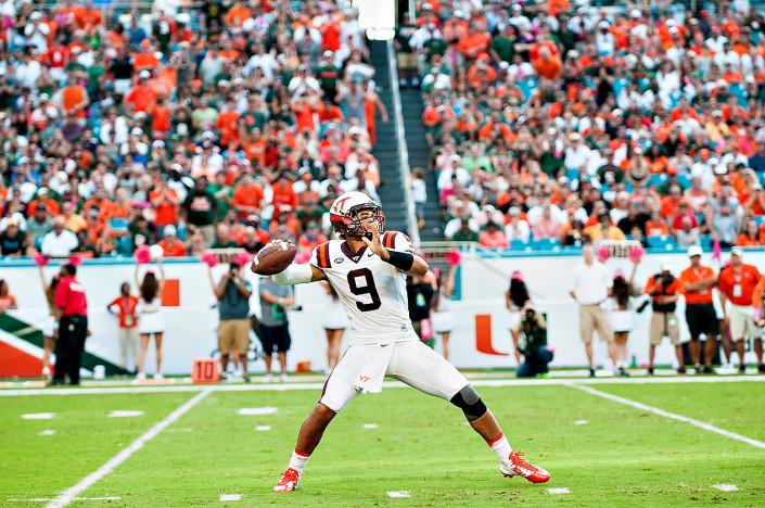 Virginia Tech QB #9, Brenden Motley, throws a pass against Miami Hurricanes