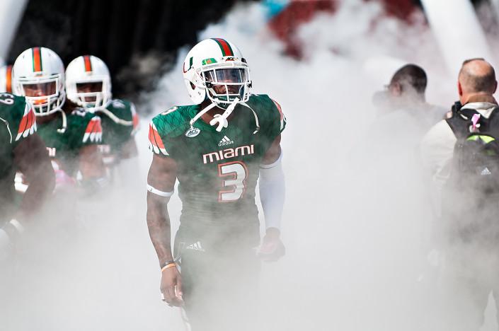 Miami Hurricanes WR #3, Stacy Coley, runs through the smoke