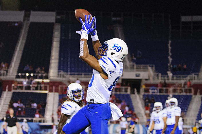 Phil Mayhue, Memphis WR, leaps for a pass in warmups