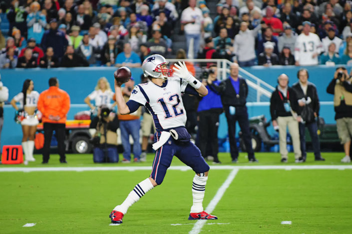 Tom Brady gears up to throw the ball
