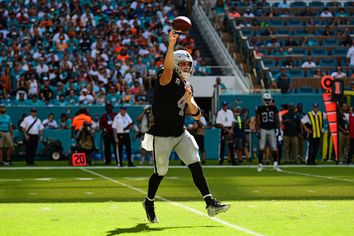 Oakland Raiders quarterback Derek Carr (4) throws on the run