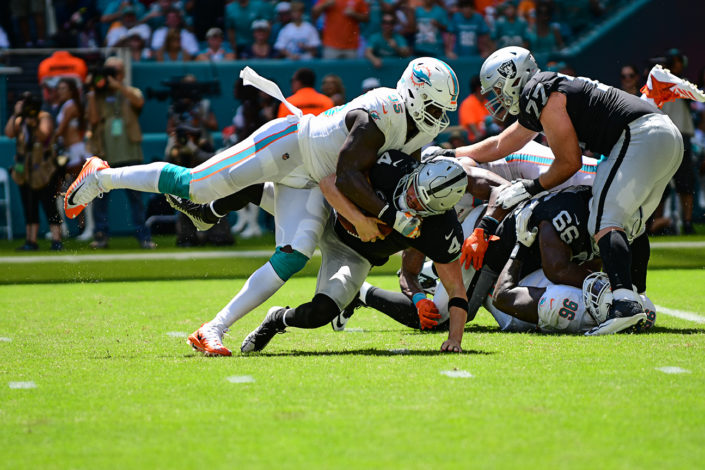 Miami Dolphins defensive end William Hayes (95) sacks Oakland Raiders quarterback Derek Carr (4)