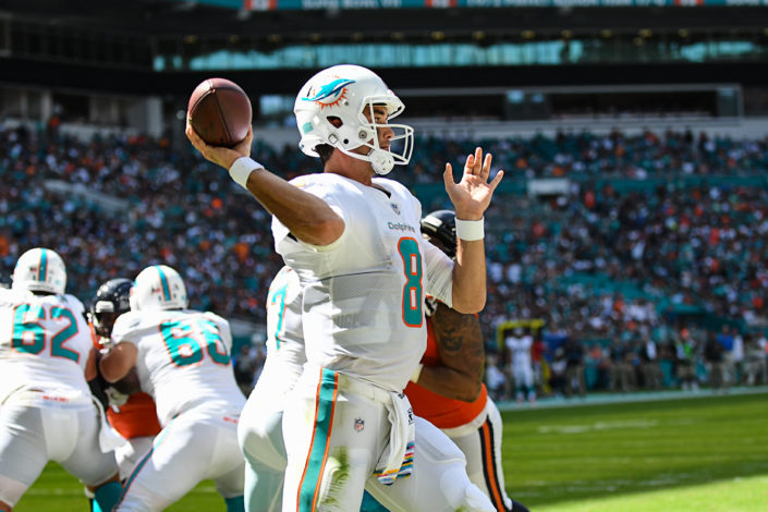 Miami Dolphins quarterback Brock Osweiler (8) throws from his own endzone