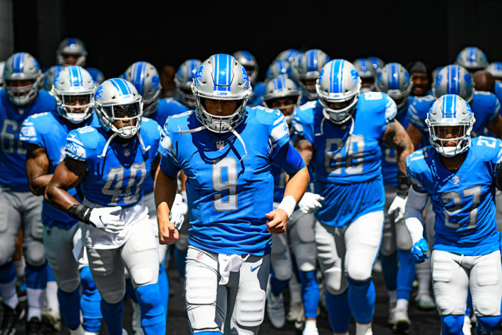 Detroit Lions quarterback Matthew Stafford (9) leads the team out to the field