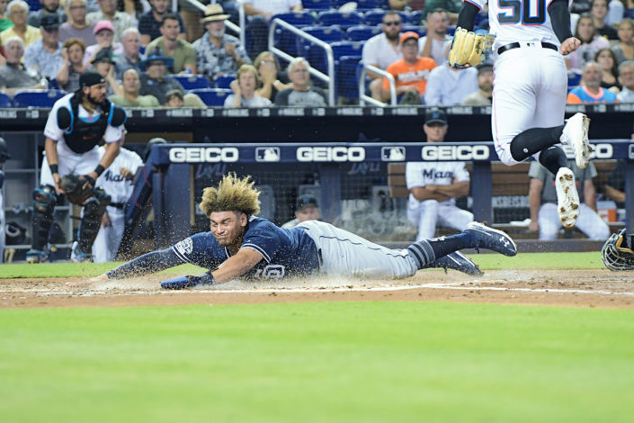 San Diego Padres Josh Naylor #22 slides across home - San Diego Padres vs. Miami Marlins at Marlins Park